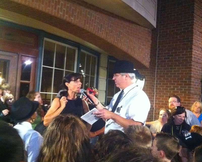 Inspector Doolittle (Joe Finn) accusing Russella Fungi (Beth Holladay) during the Murder Mystery put on by the Kennett Amatuer Theaterical Society during August's ArtWalk. .