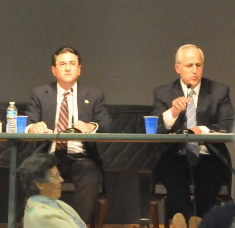 Roger Howard (left) and state Sen. Dominic Pileggi traded barbs — and showed vastly differing visions for Pennsylvania during a League of Women Voters forum Thursday night.