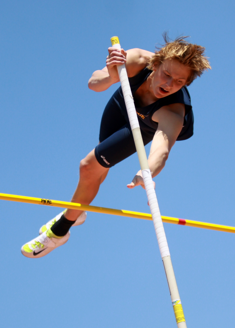 Unionville's Derek Larson clears 14 feet to set a new personal record.