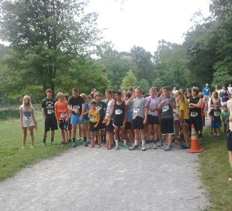 Runners line up just before the start of the Kennett Area Parks and recreation Board 1.5 mile run for kids.