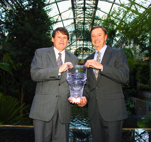 John Briscoe (left) received a glass vase created by Simon Pearce from  Stroud's director, , to commemorate the recognition.
