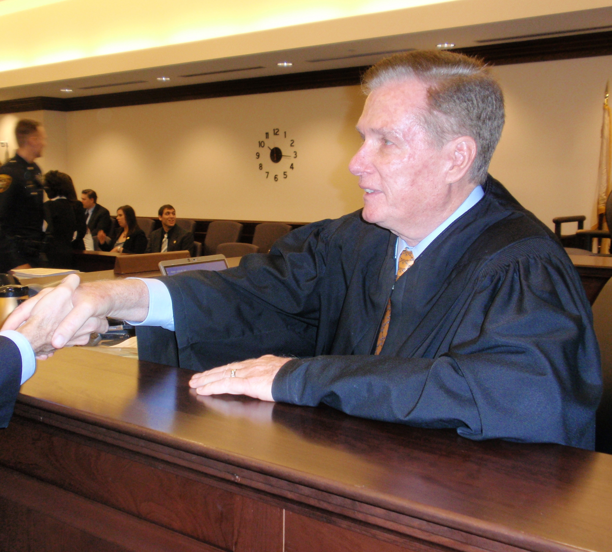 Retiring Judge Howard F. Riley Jr. shakes the hands of well-wishers after his surprise tribute.