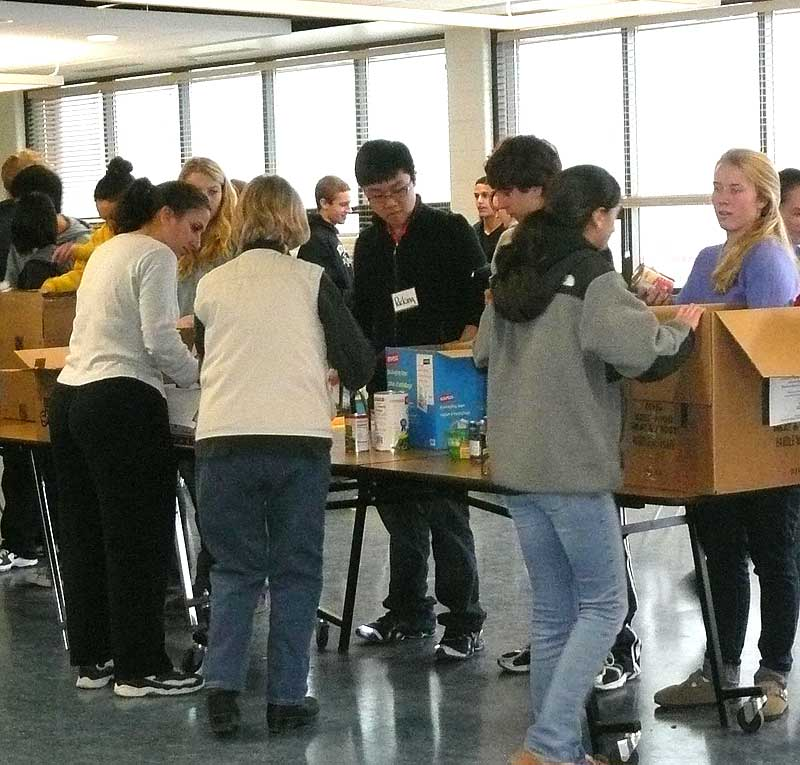 Volunteers sort through thousands of food donations for the Kennett Community Food Cupboard, Monday, as part of the Martin Luther King Jr. Day of Service.