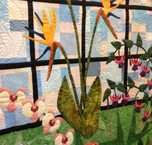 A detail from the three-paneled, light-themed quilt shows the gardens bird of paradise flowers.