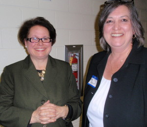 Julia Malloy-Good (left), a Family Court master, received congratulations from County Commissioner Kathi Cozzone after receiving the Democratic Party's endorsement for judge.