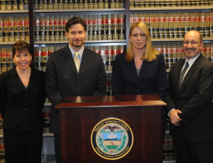 Newly promoted deputy district attorneys are Michelle Frei (from left), Mark Conte, Renee Merion, and Thomas Ost-Prisco.