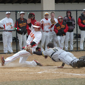 Ryan LAngerhans of Unionville makes a diving tag against West Chester East, Thursday. Photo courtesy Paul Langerhans.