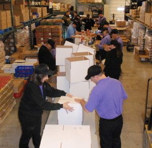 A high-energy crew of Wegmans employees formed an assembly line to sort the donation of 18,000 pounds of food.