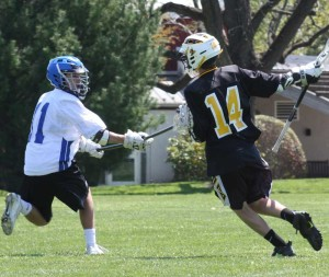 Kennett Middle School's Charlie Cordisco looks to stop Upland Country Day School's Bentley Ahl during this past weekend's Upland Invitational Lacrosse Tournament.