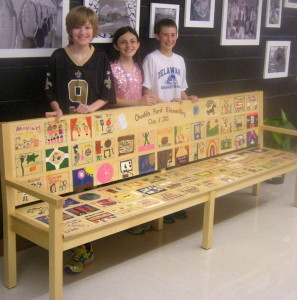 Fifth-graders Michael Walter-Dillon (from left), Katelyn Kurkewicz, and Peter Kucharczuk show off their memory-layered gift to the school.
