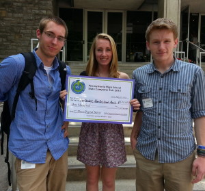 "Unionville High students Alan Dembek (from left), Molly Basilio, and Adam Carl show off their second-place prize for ""Chances of,"" a digital short movie."