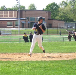 Second baseman Sean Faux trots in with Unionville's fifth run of the day