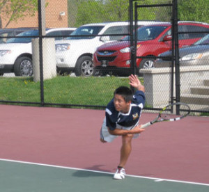Unionville High School's boys tennis team completed a fought straight perfect season in the Ches Mont, with a win over West Chester East, Tuesday. No. 1 singles player Johnny Wu follows through on a serve.