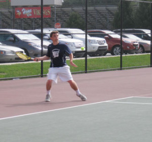 Unionville first doubles player and co-captain Jeremy Waterkotte smacks a forehand.