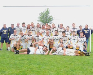 The Pennsylvania State Champion Unionville Rugby team poses with their trophy and medals after winning the title in thrilling fashion over St. Joseph's 21-14, Sunday.