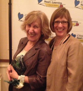 Unionville High French teacher Sue Shelley (left) celebrates with Principal Paula Massanari.