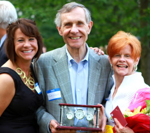 Frank Sobyak, the Chester County SPCA's board treasurer, poses with his daughter (from left), his Volunteer of the Year Award, and his wife,