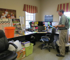 Larry Welsch, executive director of the Chester County Food Bank, surveys some of the current office space, which features overflow storage on the floor.