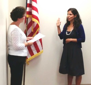 Leticia Flores DeWilde takes to oath of office from Unionville-Chadds Ford School Board President Eileen Bushelow, Monday night. Flores DeWilde replaces Frank Murphy and was appointed last month to serve through November.