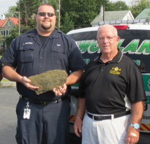 Uwchlan Ambulance Corps Member Jim Werner and Ed Toner display the shale from the Flight 93 crash site that will be memorialized at the Chester County Public Safety Training Center in South Coatesville.