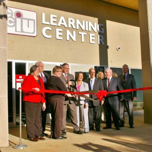 CCIU administrators and state officials cut the ribbon at the new Learning Center.