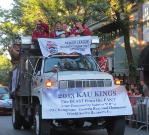 Members of the championship KAU baseball team wave to the crowds during Friday night's 2013 Mushroom Festival Parade.