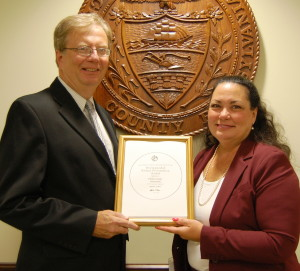 Chester County Chief Operating Officer Mark Rupsis (left) and Chester County Director of Finance Julie Bookheimer display  the Government Finance Officers Association Distinguished Budget Presentation Award for 2013.