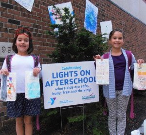 "Two girls from the YMCA of the Brandywine Valley after-school program proudly display the luminary bags they created for the National initiative, ""Lights on Afterschool."" This year's event will take place on Thursday."