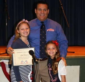 Unionville Elementary students Madeleine and Holly Cameron honor their dad, John Cameron, at the Veterans Day assembly held Monday at Unionville Elementary School.