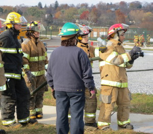Mo Lahloui (right), 17, of Parkesburg, takes his turn getting used to the force of the nozzle as instructor Reenie McCormick (dressed in blue) looks on.