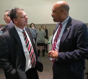 Chester County Commissioner Terence Farrell (right) discusses the Decades to Doorways initiative, with its administrator, Michael Hackman.