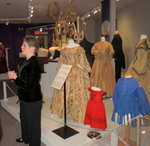 Ellen Endslow, co-curator of the fashion exhibit, discusses the Civil War influence, such as military-style embellishments, on some of the clothing worn in the 1870s.