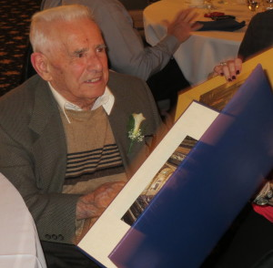 Mike DiPietro reads the many greetings that he received on his 100th birthday.