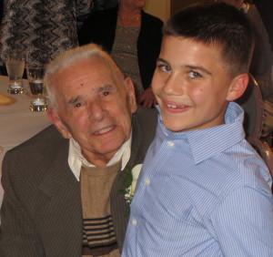 Mike DiPietro poses with 9-year-old Michael Fragale Jr., the son of DiPietro's barber.