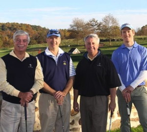 Roger Huggins (from left), Scott Gamble, George Zumbano and Basel Frens from Gawthrop Greenwood, a West Chester-based law firm, enjoy the YMCA of the Brandywine Valley's Chester County Corporate Golf Championship.