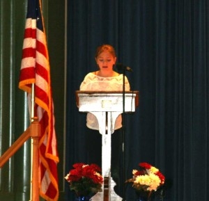 Unionville Elementary School fifth grader, Kate Holmes, talks about the history of Veterans Day at the school's special assembly.