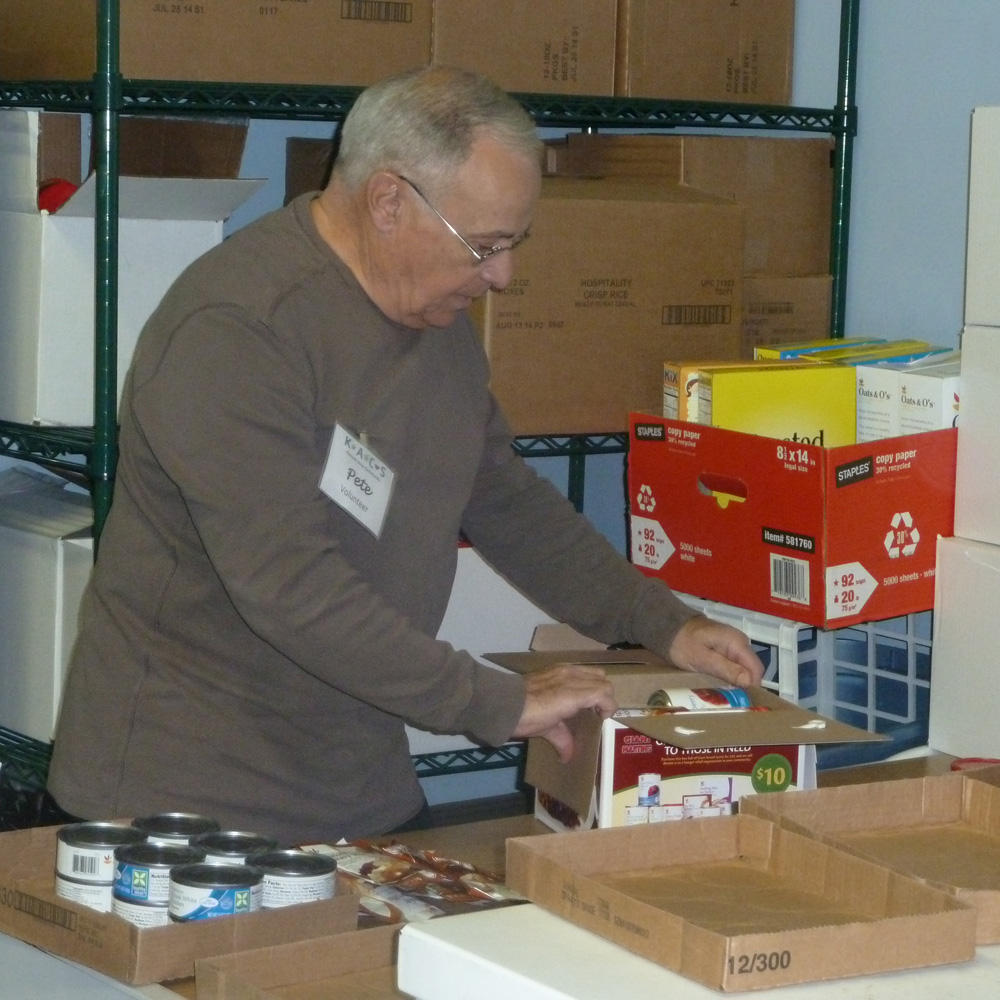 Kennett Food Cupboard Volunteer Pete D'Angelo prepares for one of the busiest times of the year as volunteers and staff sort through donations in anticipation of the Thanksgiving holiday.