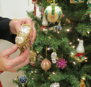 """Chester County Sheriff Carolyn """"Bunny"""" Welsh shows the intricate detail on the bottom of one of the newly acquired Christmas ornaments."""