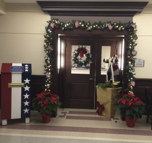 The Chester County Sheriff's Office patriotic holiday door display in the lobby of the Chester County Justice Center is now anchored by a new box, where residents can deposit U.S. flags they want to retire.
