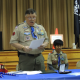 Scoutmaster, Ray Coe, awards Eagle recipient, Walip Yenbutr, with the highest rank in Boy Scouts, Eagle Scout