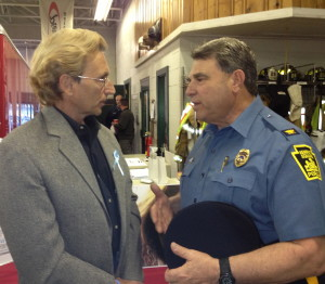 Andy Rumford (left) chats with Kennett Square Police Chief Edward Zunino after one of the community meetings he has hosted in the area to raise awareness about the dangers of heroin.