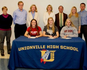 Three Unionville High School athletes announced this week that they would continue their sports careers in college: Seated from L to R are Caroline Miller, who will attend St. Joseph's, Madison Bove, who attend Towson St. in Maryland, and Janine Mueller  who will attend St. Joseph's. Pictured with the athletes from left to right are: UHS principal Paula Massanari, William and Regina Miller, Kim Bove,  UHS Soccer Coach Joe Ratasiewicz and Janine and Thomas Mueller.