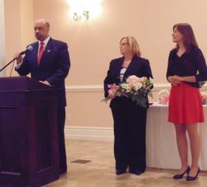 Chester County Commissioner Terence Farrell introduces Empowered Young Woman award-winner Christine Luczka (right). She is joined by Jeannine McCullough, vice chair of the Chester County Women's Commission.