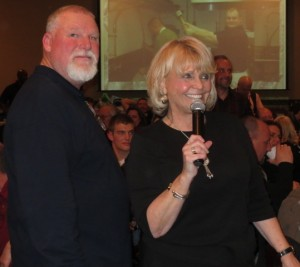 "Chester County Sheriff Carolyn ""Bunny"" Welsh thanks the crowd for attending the Fifth Annual Wild Game Dinner as Deputy Sheriff Harry McKinney gets ready to continue operating the extensive raffle."