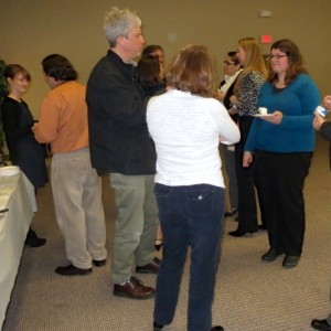 Volunteers and service providers involved in the Point-in-Time Count discuss the results with county workers, including Sarah Trentley (left) and Heather N. Charboneau (right).