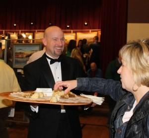 The smiling, tuxedoed wait is Unionville Supt. John Sanville, who served