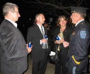 Ken Iwaniec (from left), State Police Cpl. Steven B. Ranck, Debby Iwaniec, and Kennett Township Police Chief Albert McCarthy share memories of Trooper Kenton E. Iwaniec, who was killed by a drunk-driver in 2008.