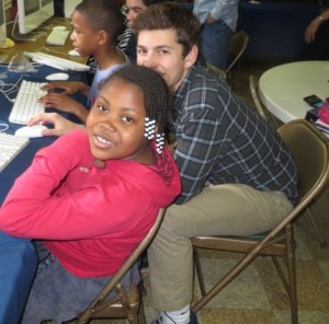 Second-grader Kanya Phipps (left), assisted by Unionville High senior Ari Bleemer, takes a break from her computer work at Study Buddies.