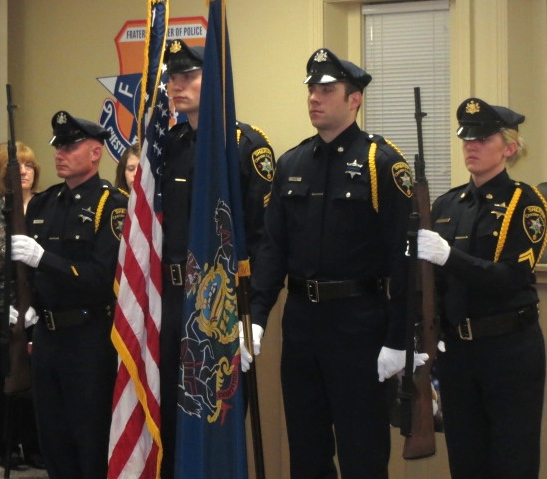 The Chester County Sheriff's Department Honor Guard stands at attention during the memorial ceremony.