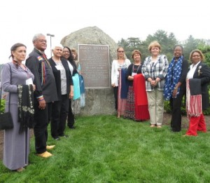 Descendants of the Lenape Indians, including Chief Dennis Coker (second from left), pose in front of the Indian Hannah memorial.